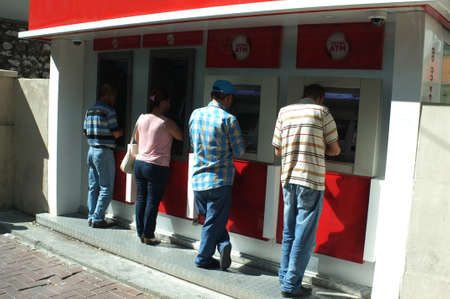 withdrawing: People withdrawing money from ATM machines