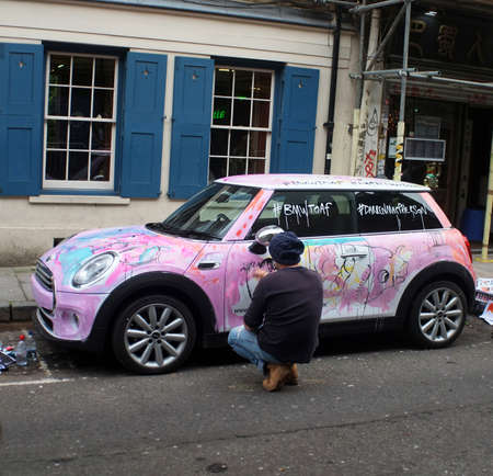 finesse: Artist painting a car Editorial
