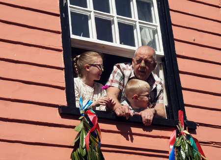 parade of homes: Grandpa with his grandchildren on the window