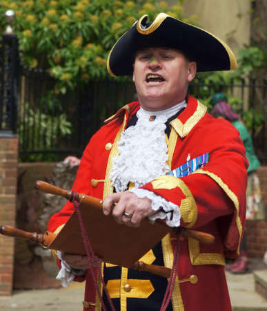 Town Crier announce the news Editorial