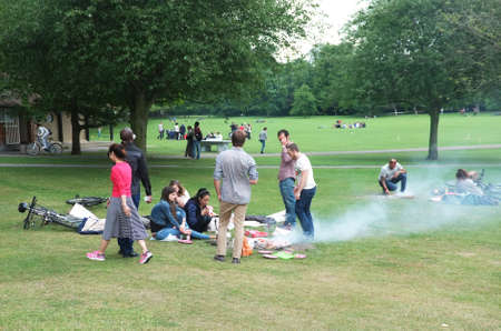 family and friends: People picnic on park Editorial
