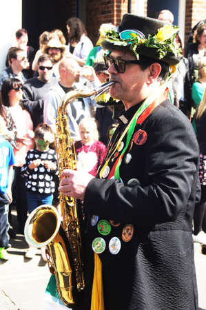 hastings: Man plays saxophone in a parade