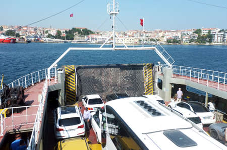 unload: Vehicles wait to unload on ferry Editorial