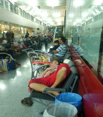 Tired passengers sleep at the airport Editorial
