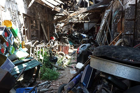 scrapyard: Waste space with many junks including motorbike Stock Photo