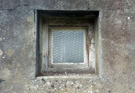 outmoded: Rusty window on building Stock Photo