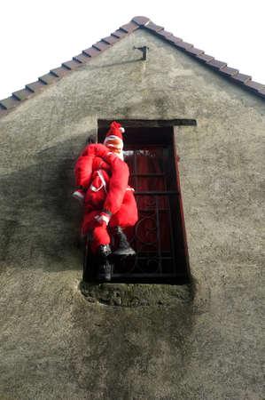 hanged: Santa puppet hanged on building