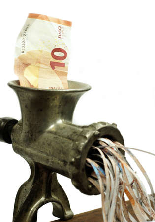 shrinking: Euro note in a meat grinder Stock Photo