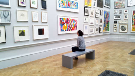 Art lover viewing art works in Royal Academy