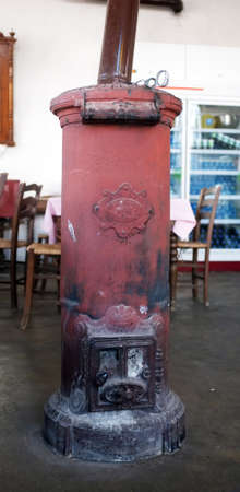 stove pipe: Brown traditional old stove in a cafe