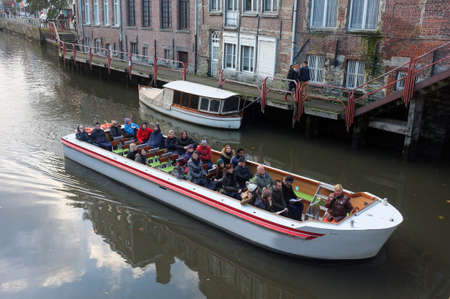 Tourists view the city on a sightseeing boat in Ghent, Belgium Editorial