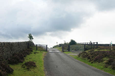 Rural country road with wooden gate in Yorkshire