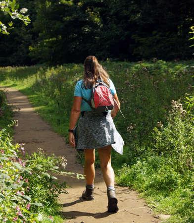 Woman is trekking with her little rucksack