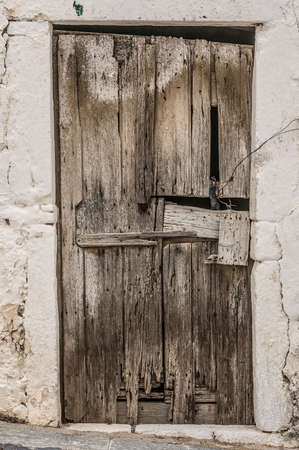 Old timber door in the scuffed wall rural scenery photo
