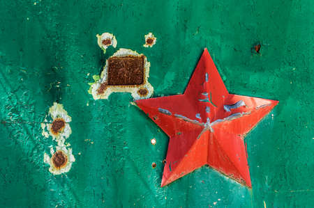 tatty: Soviet military five-pointed star on the green scuffed gate USSR