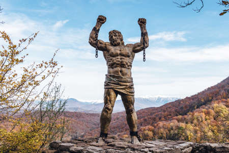 unbound: SOCHI, RUSSIA NOVEMBER 23, 2015: Statue of Unbound Prometheus with Broken Chain on the Eagle Rocks in the Caucasus Editorial