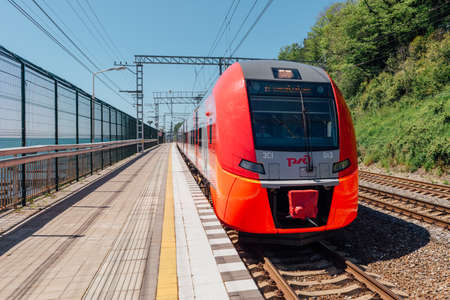 SOCHI, RUSSIA, MAY 10, 2015: Lastochka Train arrives at Matsesta Railway Station