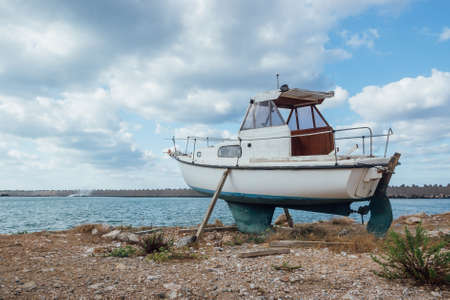 Small Old Boat Standing On The Ground Stock Photo