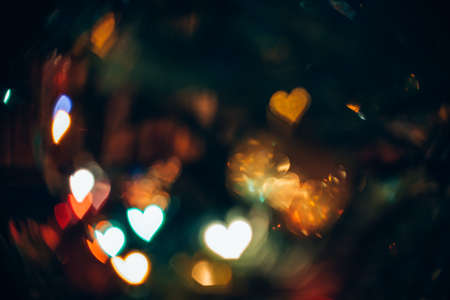 Abstract Background with Bokeh in Shape of Hearts Symbol of Love Stock Photo