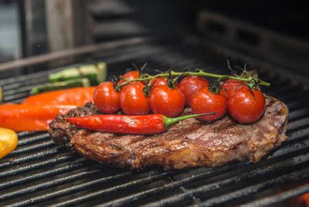 Club Steak and Grilled Vegetables Being Prepared in Josper Grill