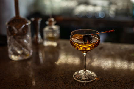 Coctail with Black Olive on the Stick on the Bar Counter 스톡 콘텐츠