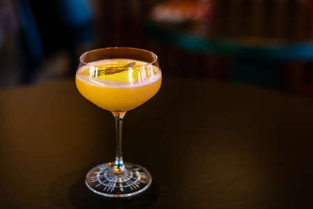 Citrus Cocktail with leaf on the Table of Restaurant