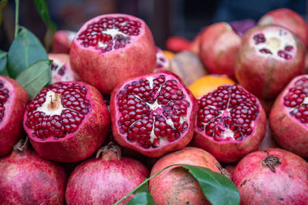 Pomegranates prepared for juice squueeze on the stall in the street 스톡 콘텐츠