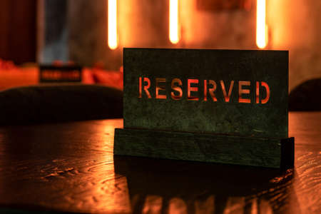 Reserved Stencil Wooden Table in the Restaurant