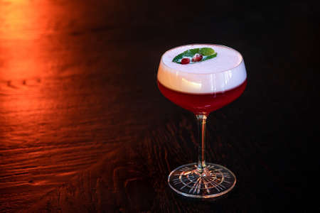 Pomegranate Cocktail with leaf and seeds on the table 스톡 콘텐츠
