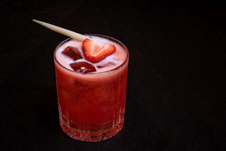 Strawberry and Cucumber Cocktail with Ice on the table 스톡 콘텐츠