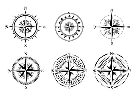 Collection of symbols of the compass. Stylized sea compasses with a wind rose. Measuring device.