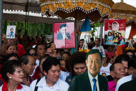 nonthaburi: NONTHABURI, THAILAND - JULY 26 : Thailand the Red Shirt hand holding picture of Thaksin Shinawatra for his birthday on July 26, 2013 in Nonthaburi, Thailand. Editorial