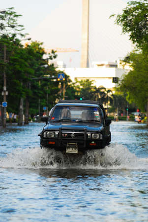 decades: BANGKOK, THAILAND - OCTOBER 30 : Unidentified people use 4x4 off road to transportation through water during the worst flooding in decades on OCTOBER 30,2011 Bangkok, Thailand. Editorial