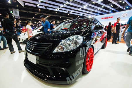 showed: NONTHABURI, THAILAND - APRIL 4 : Nissan Almera showed in 34th Bangkok International Motor Show on APRIL 4, 2013 in Nonthaburi, Thailand.