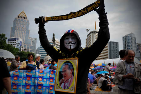 guy fawkes: BANGKOK - AUGUST 4  Protester hold an anti-government rally in Lumpini Park on AUGUST 4, 2013 in Bangkok, Thailand  The protesters call for the government to be overthrown