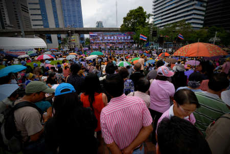 overthrown: BANGKOK - AUGUST 4  Protester hold an anti-government rally in Lumpini Park on AUGUST 4, 2013 in Bangkok, Thailand  The protesters call for the government to be overthrown