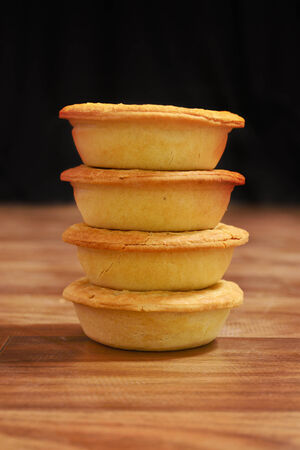 tucker: Stack of meat pies