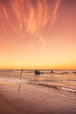 qld: The S.S Dicky Shipwreck at Dicky Beach. Afternoon sunset in the Sunshine Coast, QLD, Australia.
