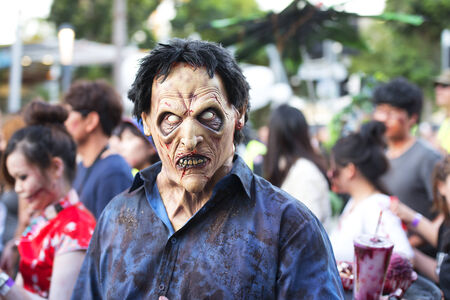 west end: Brisbane, Queensland, Australia - October 5th 2014: Annual brain foundation zombie walk October 5th, 2014 in West end, Brisbane, Australia. Crowd of participants on the day walking the street.