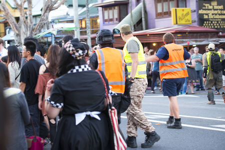 west end: Brisbane, Queensland, Australia - October 5th 2014: Annual brain foundation zombie walk October 5th, 2014 in West end, Brisbane, Australia. Crowd controllers controlling streets.