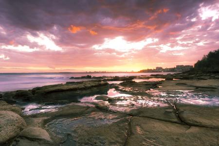qld: Rocks and waves at Kings Beach, QLD.