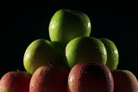 low key lighting: Apples red and green with low key lighting.