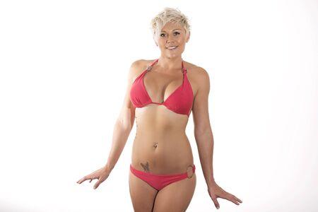 whitern: Young blonde female in swimwear posing in studio