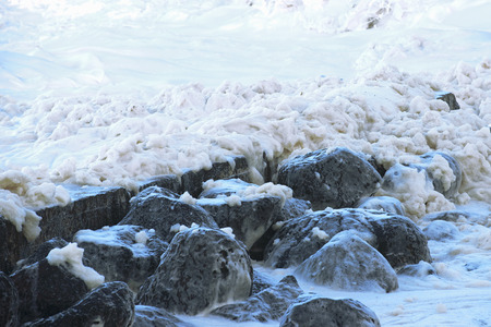 agitation: Sea foam created by the agitation of seawater located at Snapper Rocks Gold Coast New South Wales border.