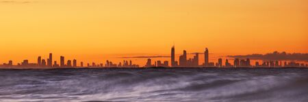 View of the Gold Coast including silhouette of the skyscrapers in the late afternoon. Stock Photo