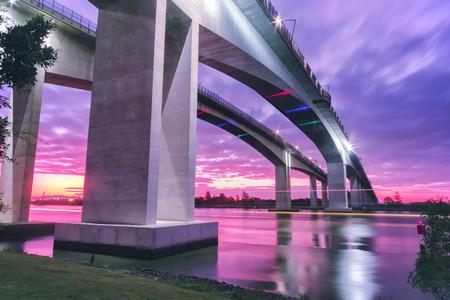 The Gateway Bridge Sir Leo Hielscher Bridges at sunset in Brisbane Queensland Australia.