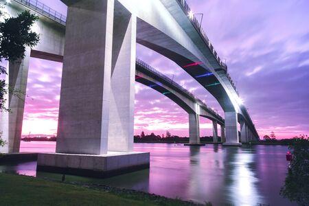 bridge: The Gateway Bridge Sir Leo Hielscher Bridges at sunset in Brisbane Queensland Australia.
