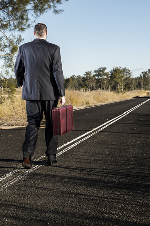 cinematic: Concept: A frustrated business man is leaving the corporate lifestyle and chasing freedom in the outback of Queensland, Australia. Cinematic Portrait Style. Stock Photo