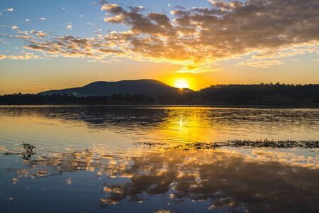qld: Beautifully rich coloured sunrise at Lake Moogerah in Queensland, Australia Stock Photo