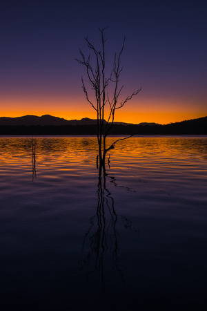 qld: Beautifully rich coloured sunset on a winters evening at Lake Moogerah in Queensland, Australia